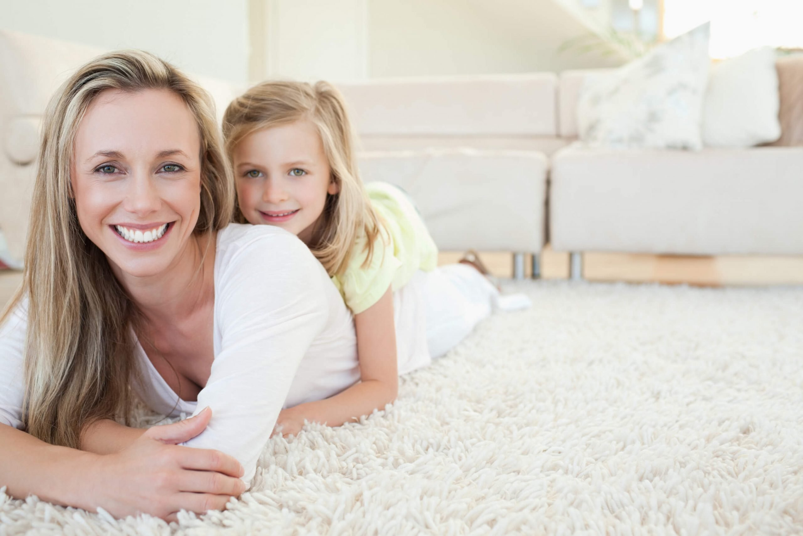 mother and daughter laying on clean carpet in long beach home